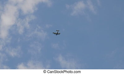The An-2 aircraft flies in the sky.