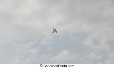 The An-2 aircraft performs a barrel. - The An-2 aircraft...