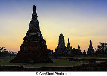 the ancient Buddha temple at Ayuthya historical park with the twilight time ,silhouette pagoda