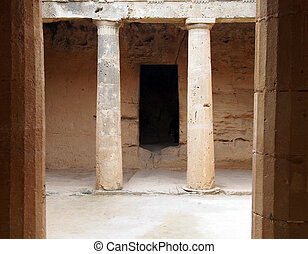 The ancient burial chamber with columns and doorway of tomb number 3 at the 'Tomb of the Kings' necropolis in Paphos, Cyprus.