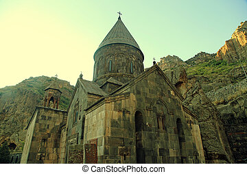 ancient Christian temple Geghard in the mountains of Armenia.