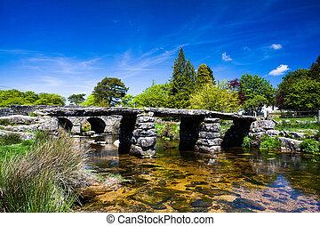 The ancient clapper bridge at Postbridges in Dartmoor...