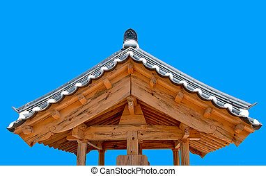The Ancient roof of korea style on blue sky background