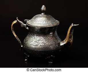 The ancient silver kettle.