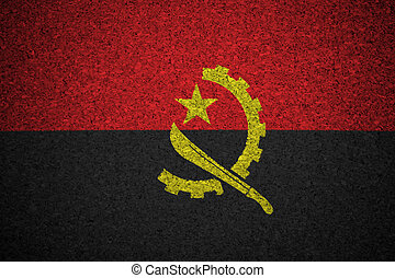 The Angolan flag painted on a cork board.
