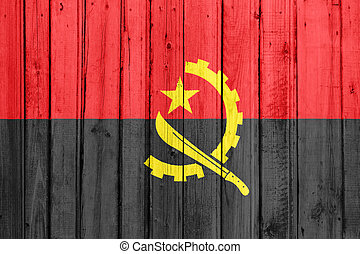 The Angolan flag painted on a wooden fence