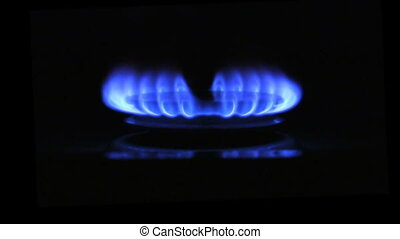 The appearance of a blue flame of gas. Gas stove on a black background