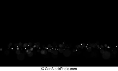 The appearance of defocused on a black background flashing round balls of white HD