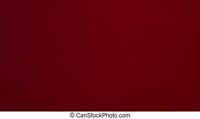 The appearance of unfocused red light highlights on a black background