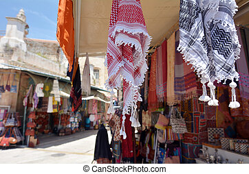 Arab keffiyeh on display in a store at the Arab market of the old city Jerusalem, Israel.