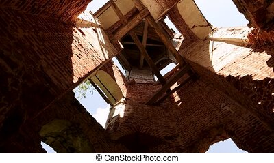 The arch of the dome of the destroyed bell tower of red brick.