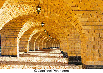The arched stone colonnade with lanterns - The arched stone...