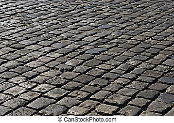 The area paved with stone. - The area paved with rectangular...
