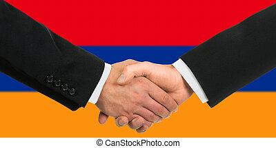 The Armenian flag and business handshake