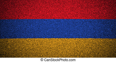 The Armenian flag painted on a cork board.