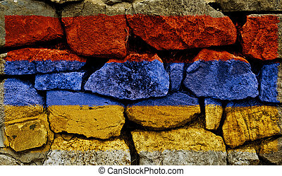 The Armenian Flag painted on to a stone wall.