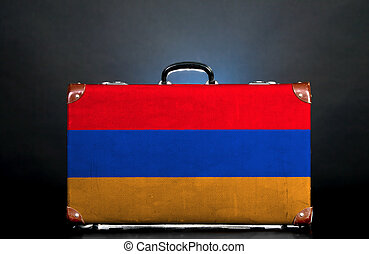 The Armenian flag on a suitcase for travel.