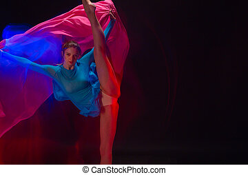 The art photo-emotional dance of beautiful blue woman