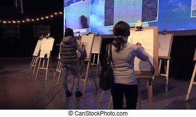 The artist paints a picture of a pencil. 4K.