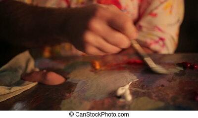 The artist paints a picture
