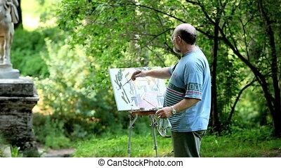 The artist, paints horse figures