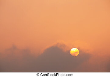 The ash cloud from the Icelandic volcano produces a hazy, fiery sunset in Southern England (April 2010) With space for your text / editorial overlay