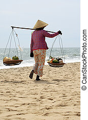 Asian woman - The Asian woman selling fruits on seacoast