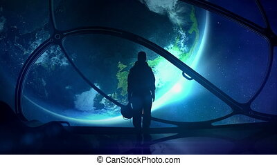 The astronaut looks at the globe