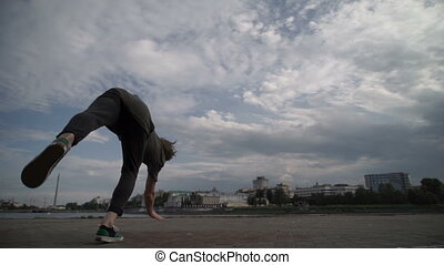 The athlete makes a multiple somersault on the street