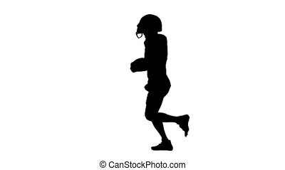 The athlete runs with the ball and in the football form. Silhouette, white background.