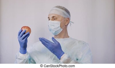 The attending physician shows the patient an apple. These...