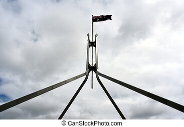 The Australian flag flying on top of Parliament House