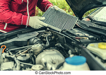 The auto mechanic replaces the car's interior filter. - Auto...