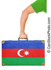 The Azerbaijani flag on a suitcase. Isolated on white.