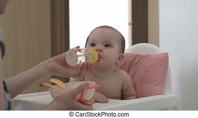 The baby drinks water