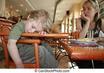 The baby fell asleep waiting for dinner. Latvia, Jurmala. In...