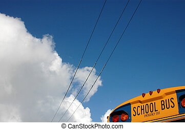 The back of a school bus against a blue sky