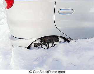 The back of a silver car stuck in a snowdrift