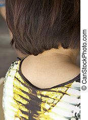 The back of a woman with short hair