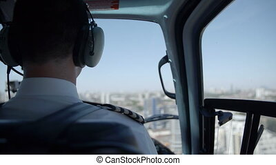The back of pilot in a helicopter