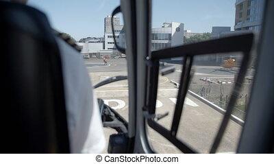 The back of pilot while preparing landing - Close up shot of...