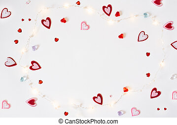 The background of Valentine's day. Frame from a Variety of different hearts and sparks on white background