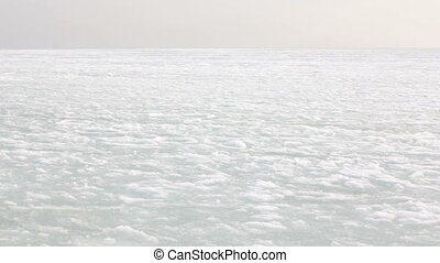 The background of white snow and spring thaw during the Far...