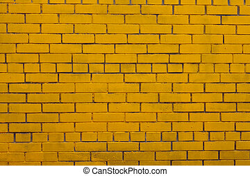 Background with old yellow painted brick wall