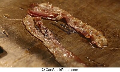 The bacon which is fried in butter. - The bacon which is...