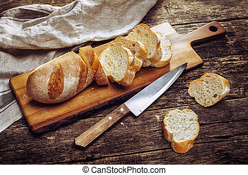 The baguette slices on a cutting board