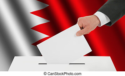 The Bahraini flag and the hand with the bulletin about the ballot box
