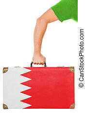 The Bahraini flag on a suitcase. Isolated on white.