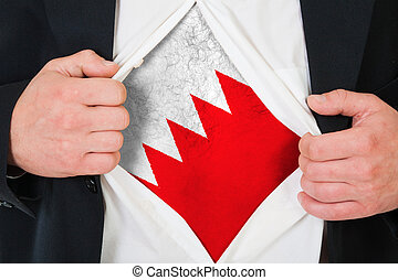 The Bahraini flag painted on the chest of a man