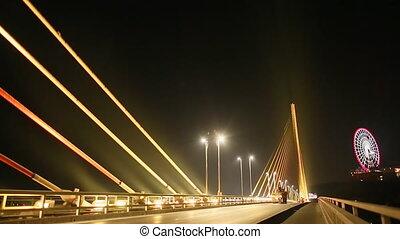 The Bai Chay Bridge in Ha Long, Traffic at night.